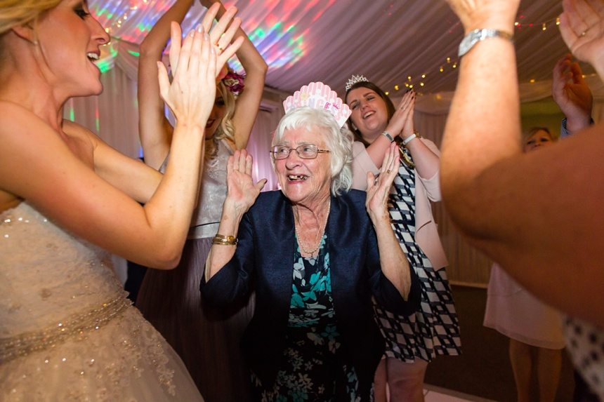 Fun Wedding Photography grandmother on dance floor clapping
