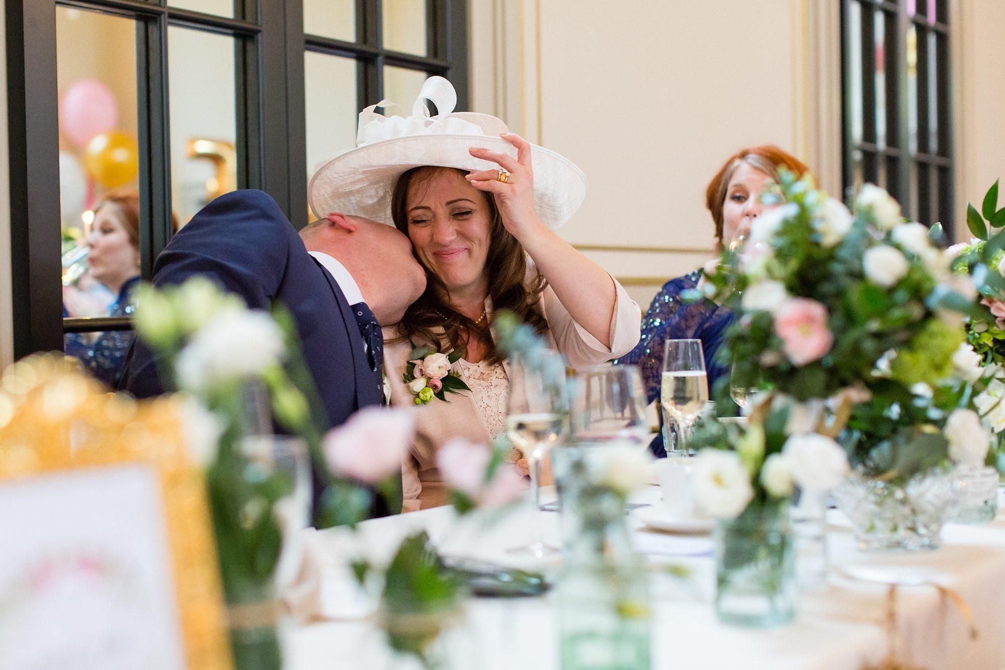 Groom Speech Advice Kissing bride on neck in York wedding