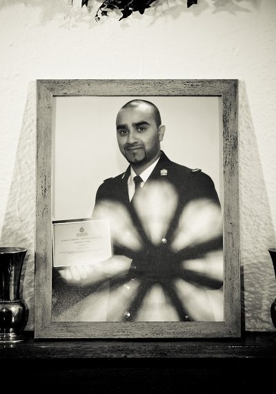 Photograph of a police officer with a rosette reflection