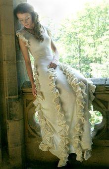 A bride wears a knitted wedding dress.