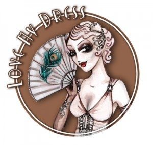 A badge with a vintage woman holding a fan which says Love My Dress