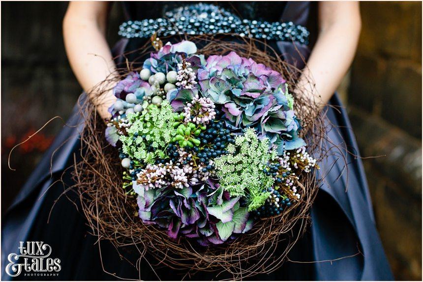 Hydrangea bouquet in bridsnest alternative wedding flowers black wedding dress