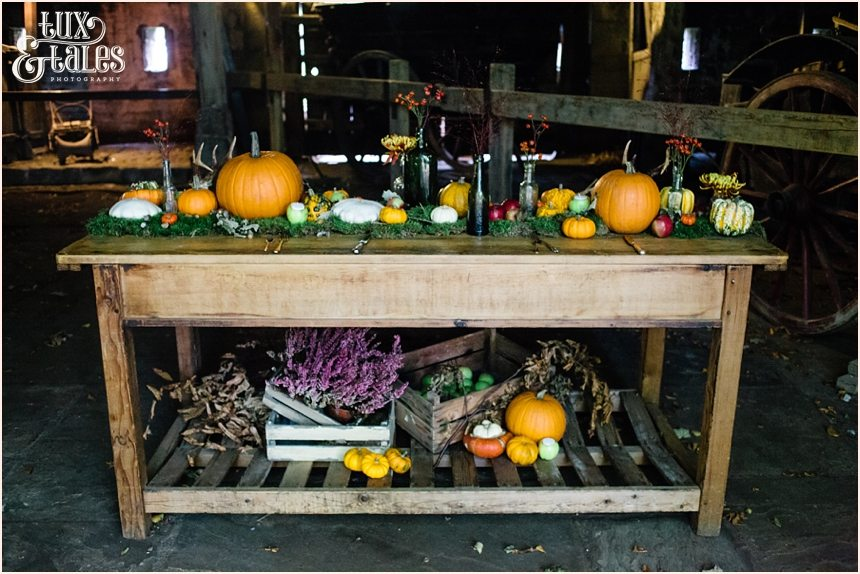 Autumn themed wedding table with pumpkins and miss