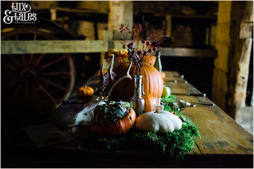 Autumn themed wedding table with pumpkins and moss