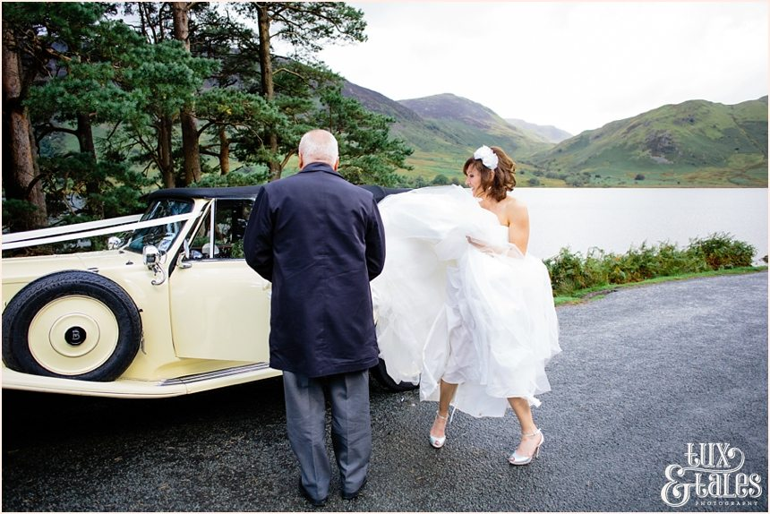bride gets out of car at Lake Buttermere