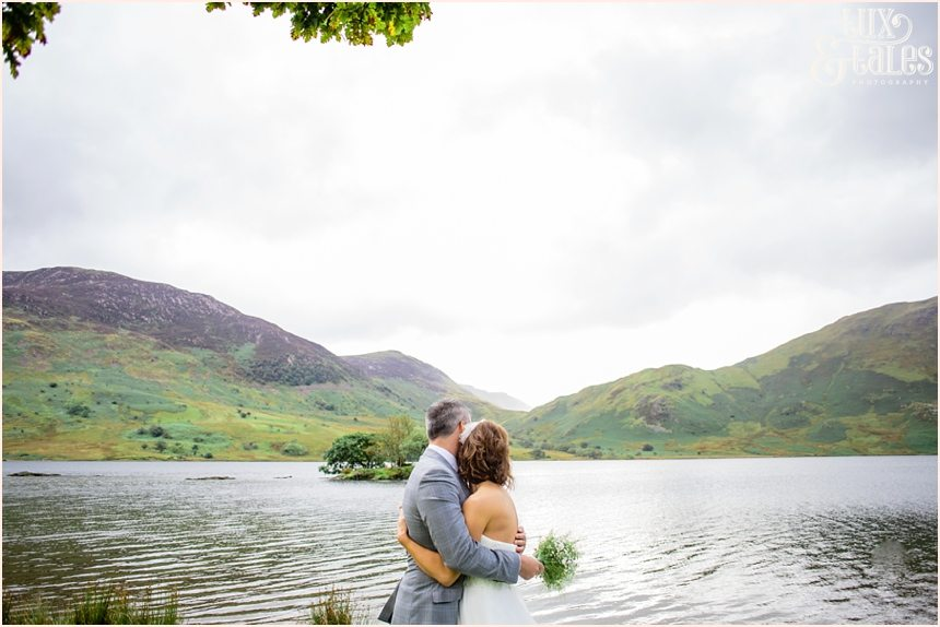Brid e& groom look out over lake buttermere