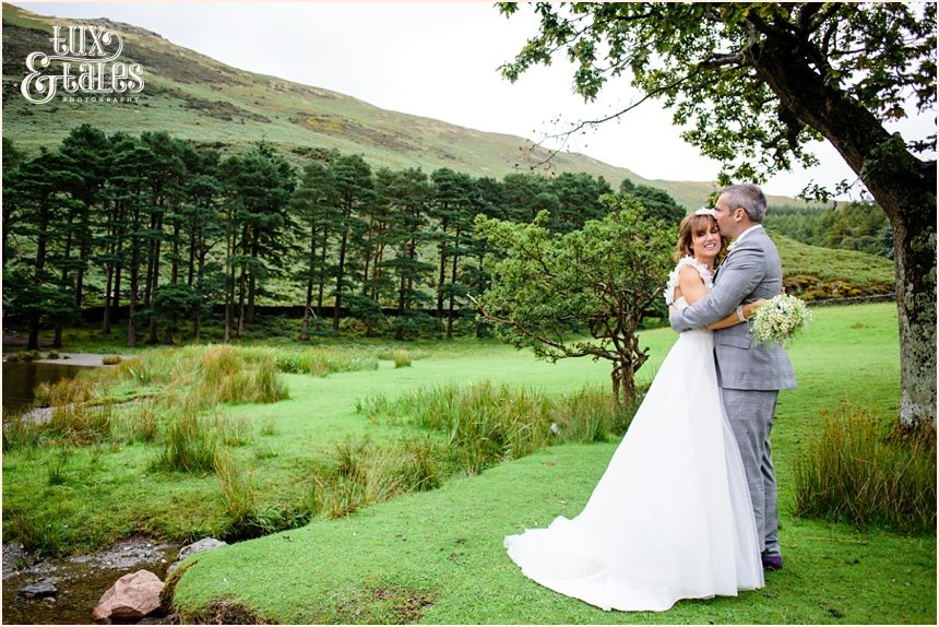 Bride and groom at LAke District Wedding by the water