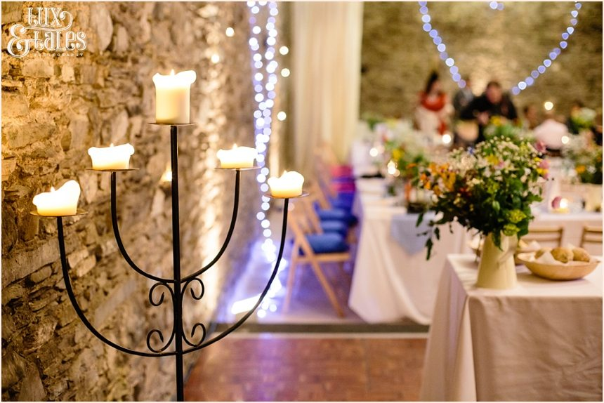 Barn wedding details with candelabra and fairy lights at Lake District wedding