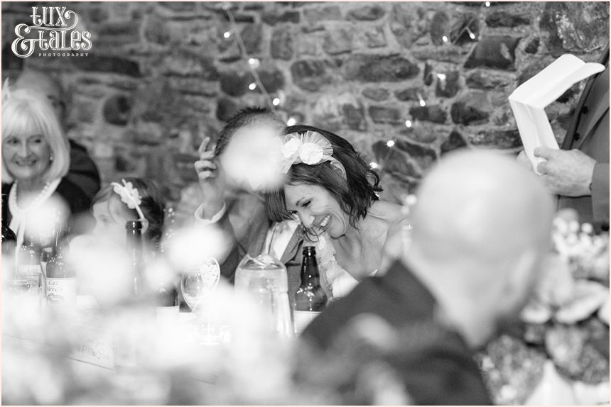 bride laughs during speechest at wedding at New House Farm in the lake district