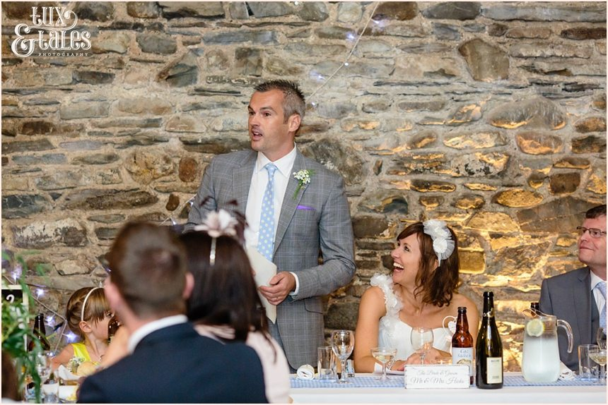 Groom gives a speech in the barn at New House Farm int he Lake District
