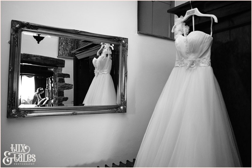 Reflection of bride and wedding dress in the mirror at lake district wedding
