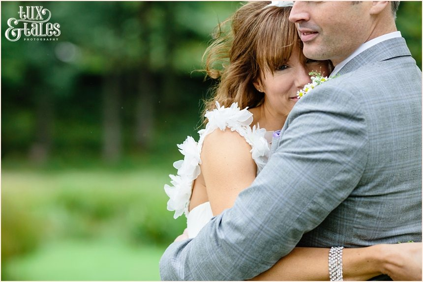 Bride and groom embrace at lake buttermere wedding