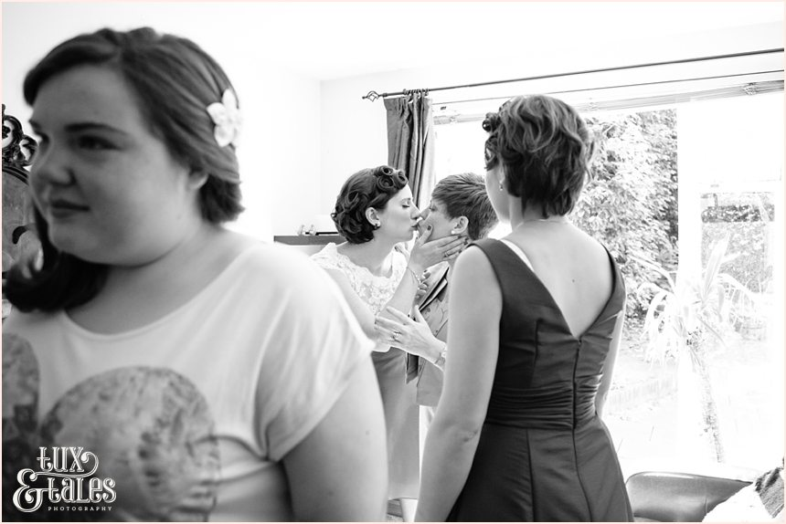 Bride kisses mum in Kew Gardens Tattoo Bride wedding