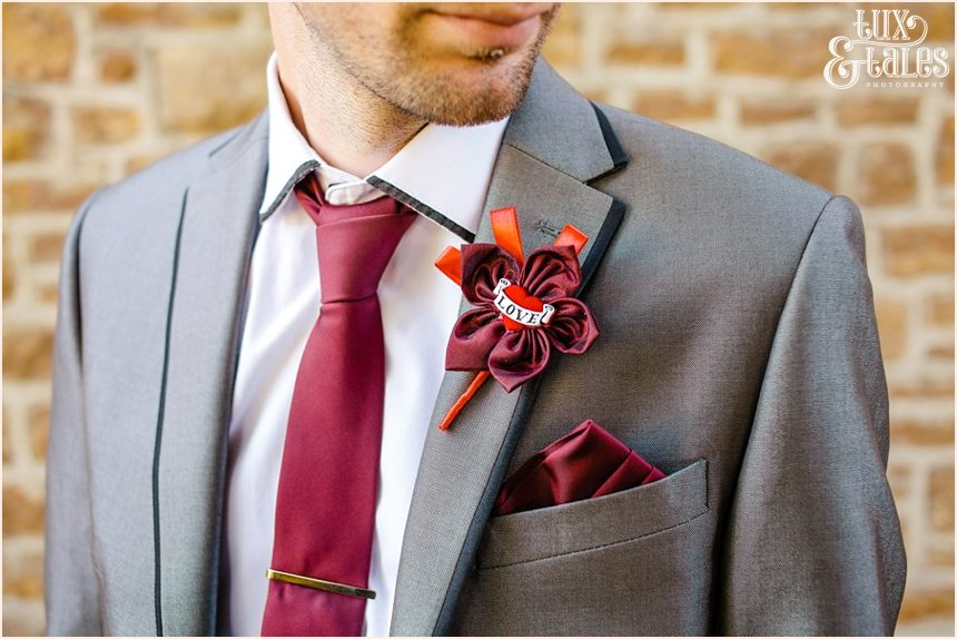Homemade red tattoo themed buttonhole