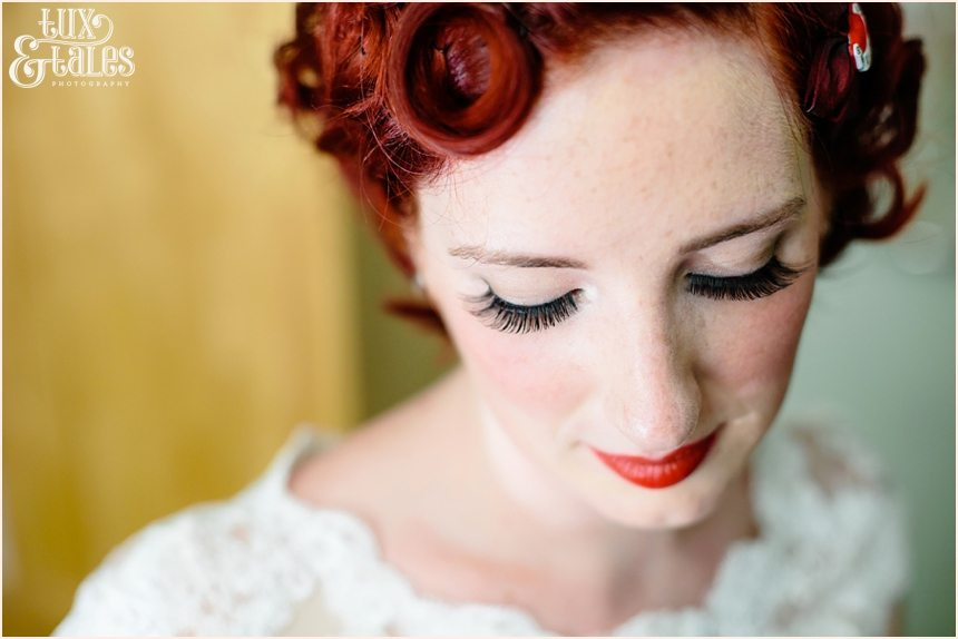 Red headed tattooed bride in portrait with pretty freckles