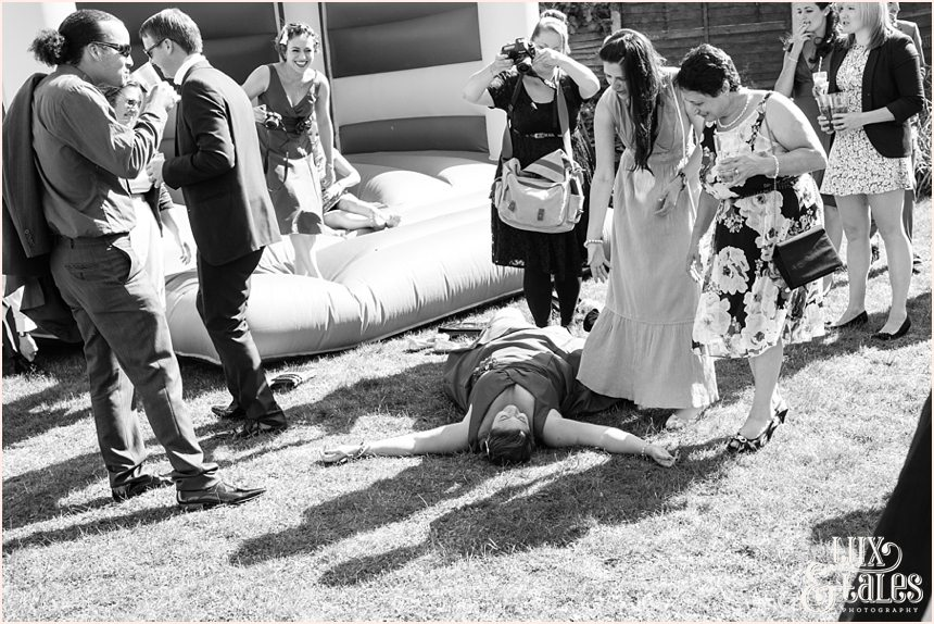 Bridesmaid falls out of bouncy castle and photographer snaps picture