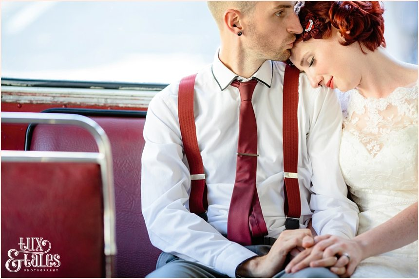 Tattoo bride embraces husband on London Bus