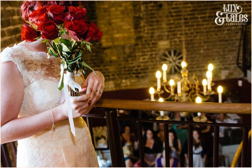 Bride thows bouquet over balcony at London wedding