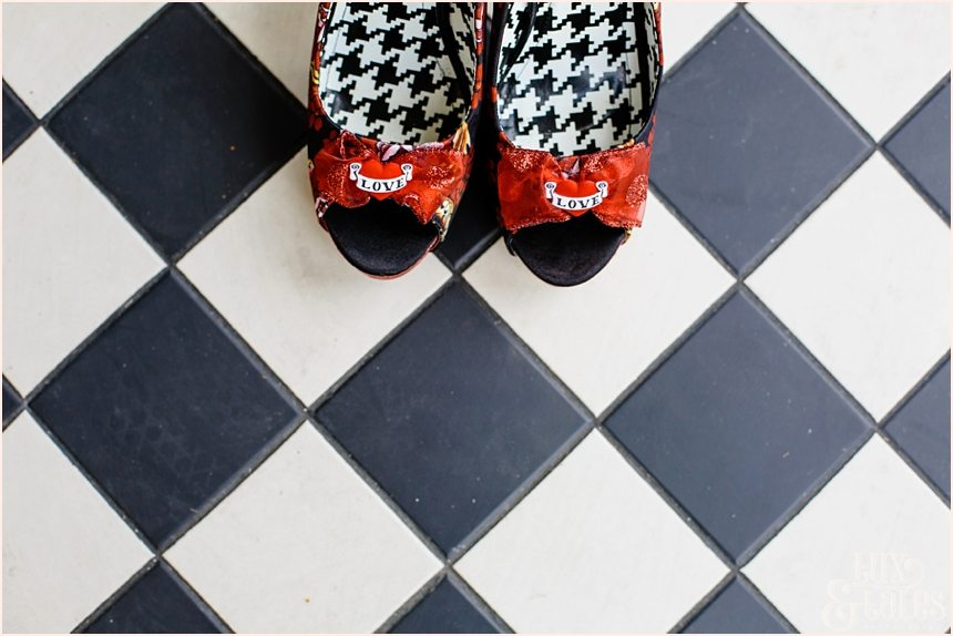 Red and Black tattoo shoes on a chequered floor