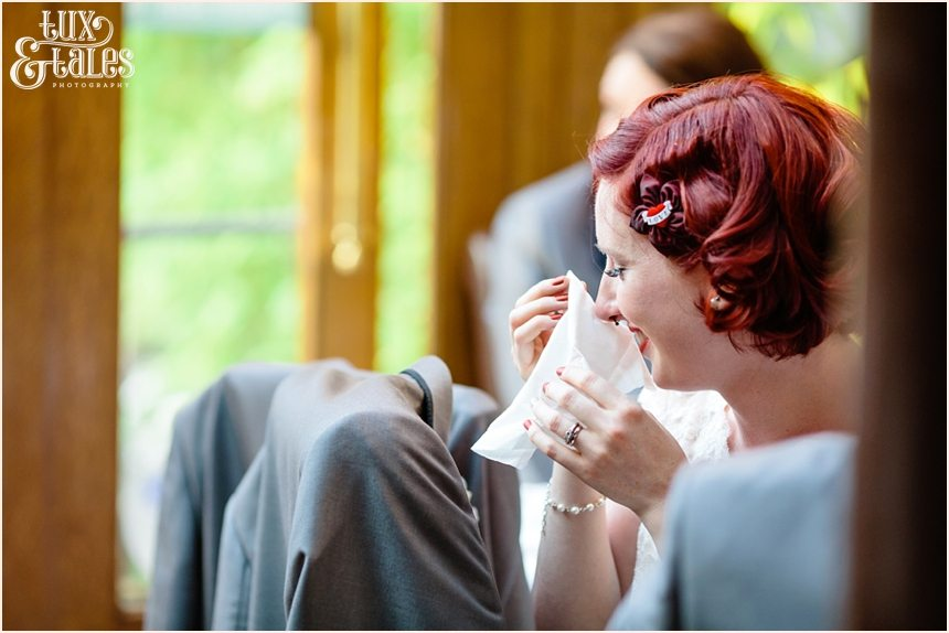 red headed bride cries at wedding