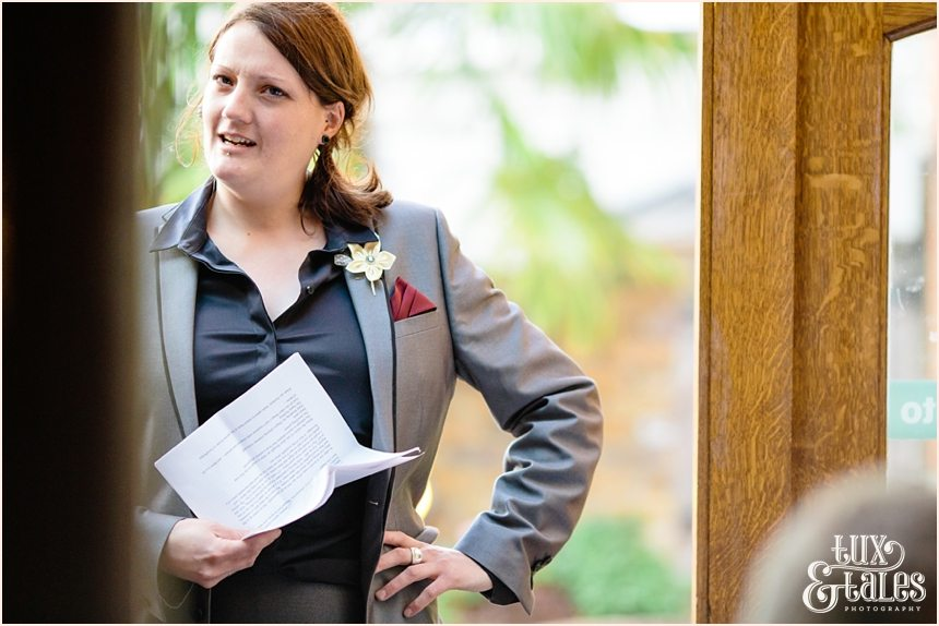 Female Best man gives speech at wedding