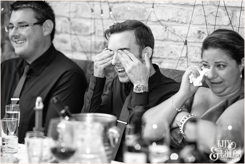 Guest covers his eyes in a joke at wedding