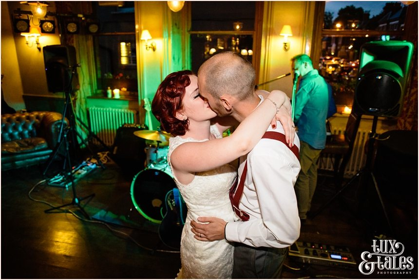 Alternative couple kiss at wedding dance