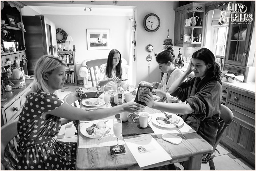 Relaxed Natural wedding p[hotography with bride and bridesmiads having breakfast in York