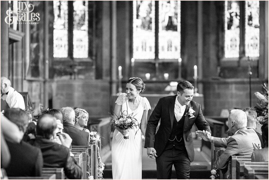 Bride & Groom walk back up aisle at York wedding Barmbyfield Barn