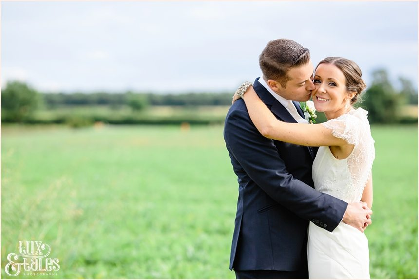 Barmbyfield Barn Wedding photography couple embracing in field