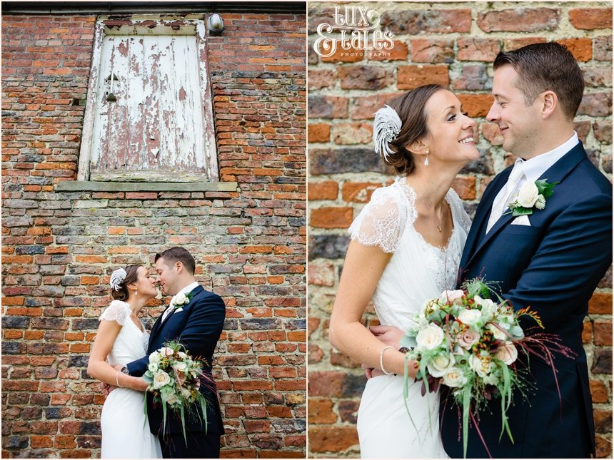 Barmbyfield Barn wedding Photography couple in front of brick wall