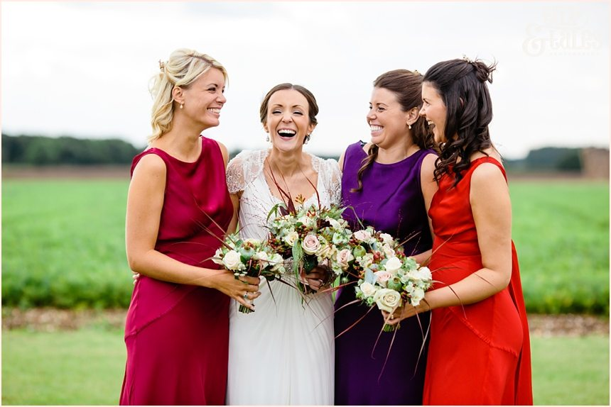 Autumn coloured bridesmiads dresses barmbyfield barn wedding