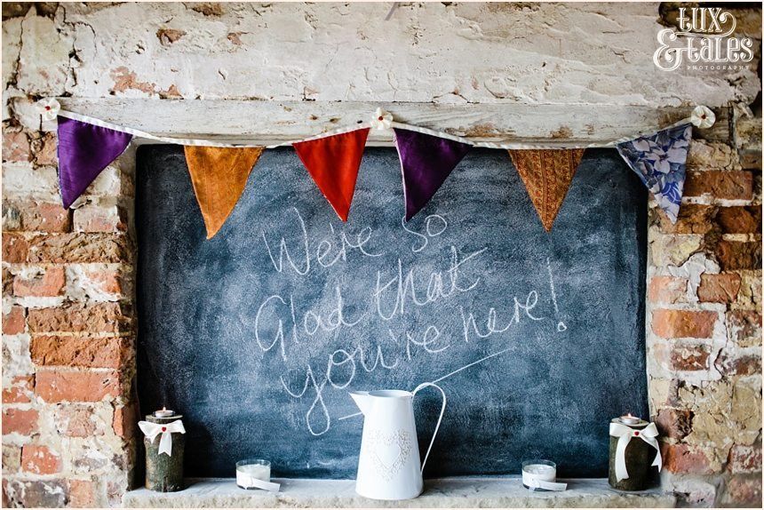Chalkboard  with bunting at barmbyfield barn wedding