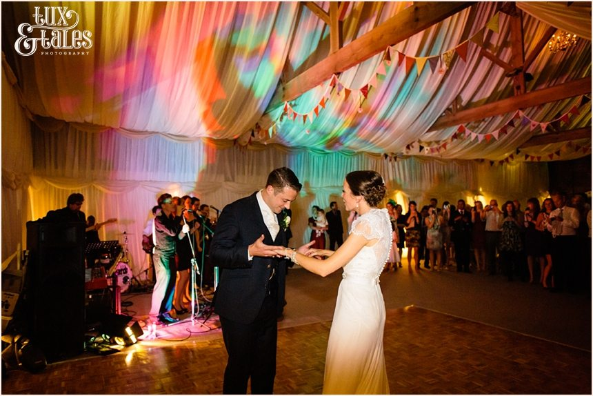 Bride and groom colourful first dance at barmbyfield Barn