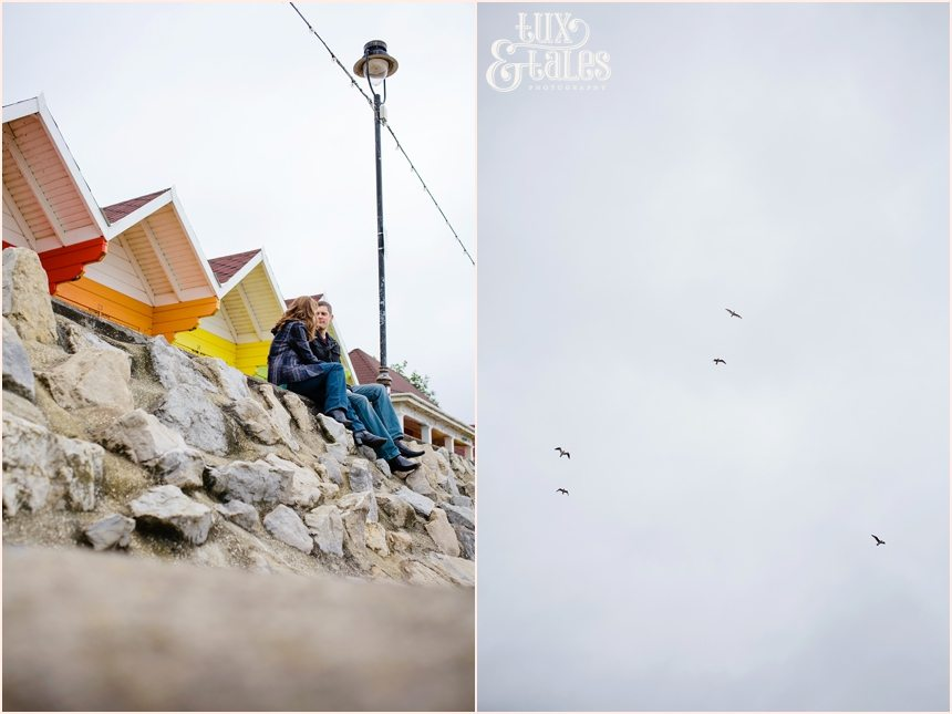 Engagement shoot in front fo rainbow coloured beach huts scarborough wedding photography