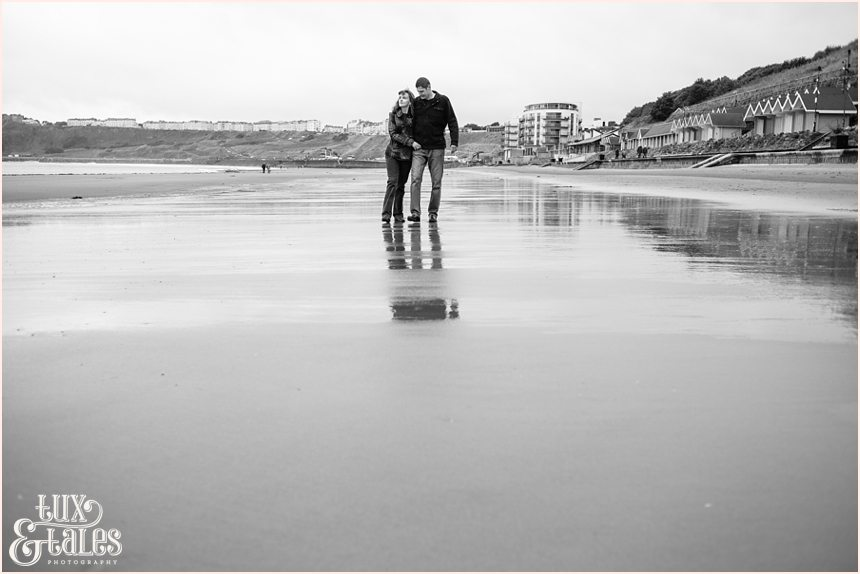 beach engagement photography poses with reflections in the sand