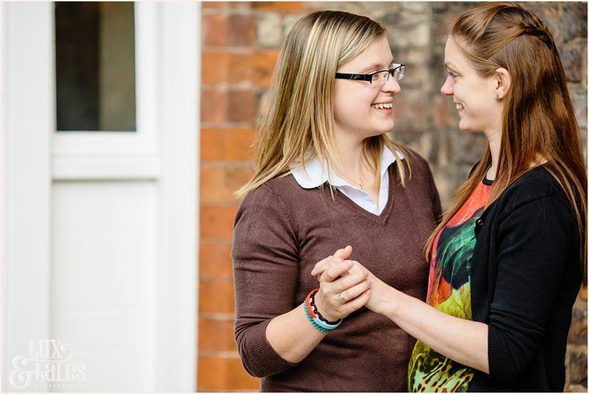 Two girls holding hands in civil partnership engagement shoot York St John University