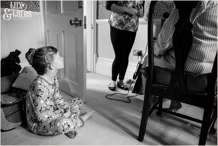 Little girl watches as mother gets ready for vintage 1950s themed wedding