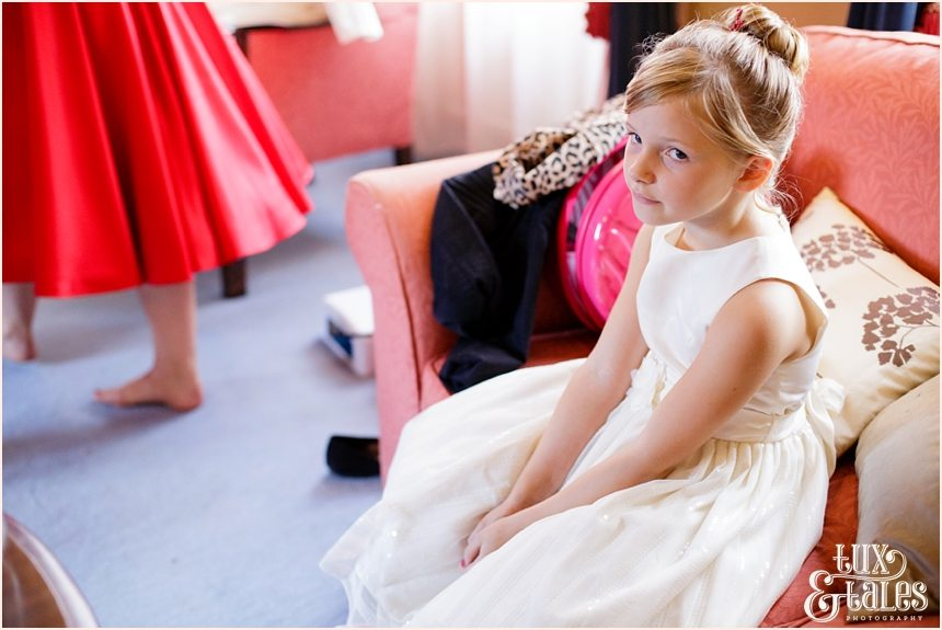 Bridesmaids makes an exasperated face at vintage themed wedding