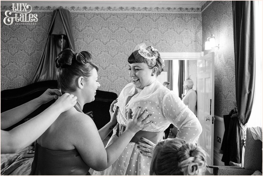 Bridesmaid grabs brides boobs being funny and joking at vintage themed wedding