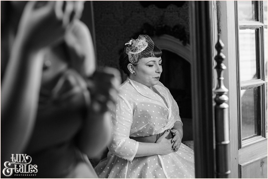 Bride in mirror at vintage themed weddign couture company wedding dress
