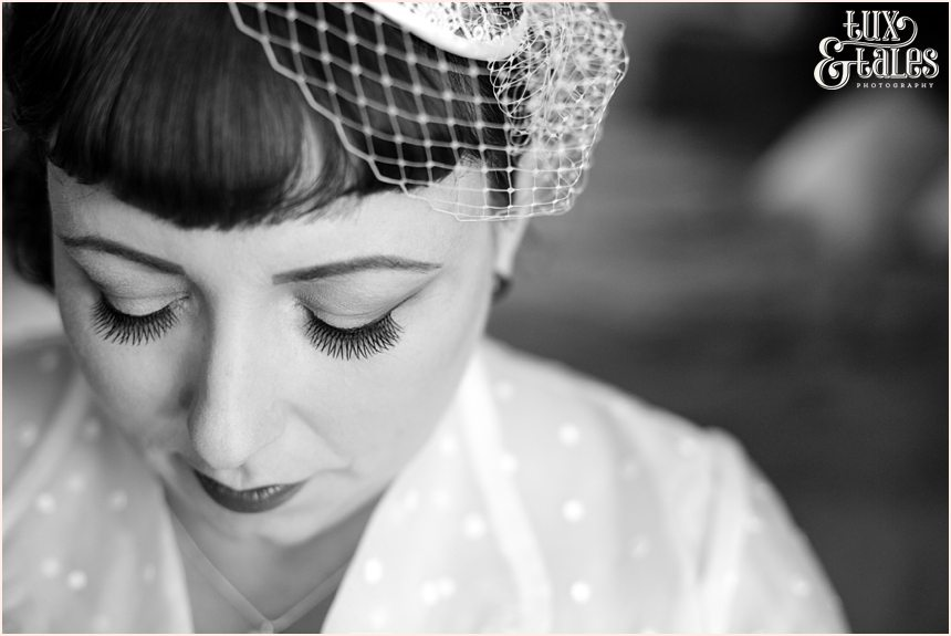 Bride at vintage thmed wedding with red heart details in couture company dress