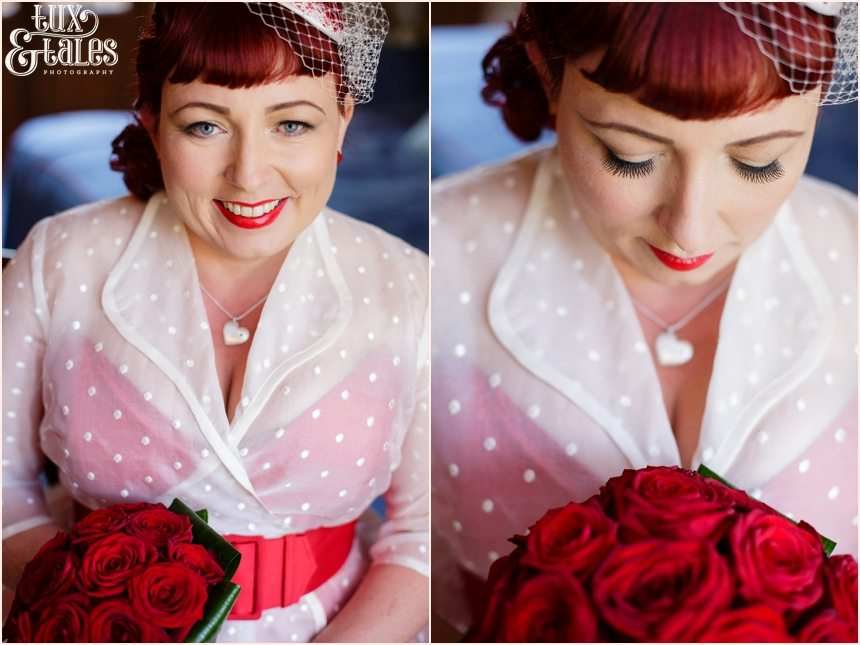 Bride in 1950s themed wedding with read heart details in a couture company wedding dress