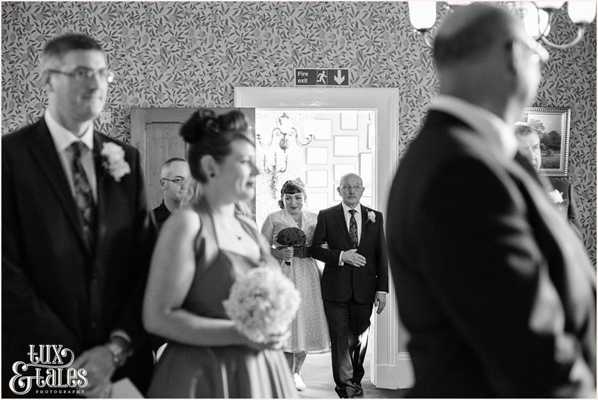 Vintage themed bride walks up aisle in yorkshire wedding