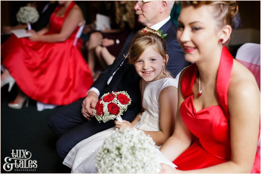 Bridesmaid smiles during wedding ceremony at Yorkshire vintage thmed red heart details