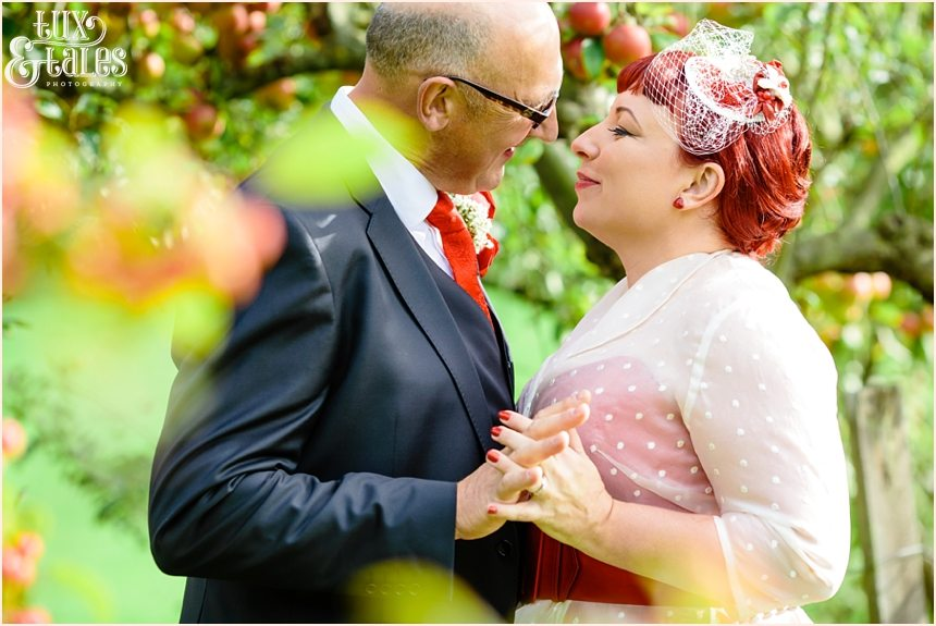 Wedding pose in apple orchard with a vintage bride in yorkshire
