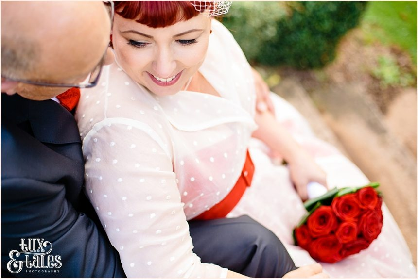 Vintage bride pose with red details in Yorkshire Photography