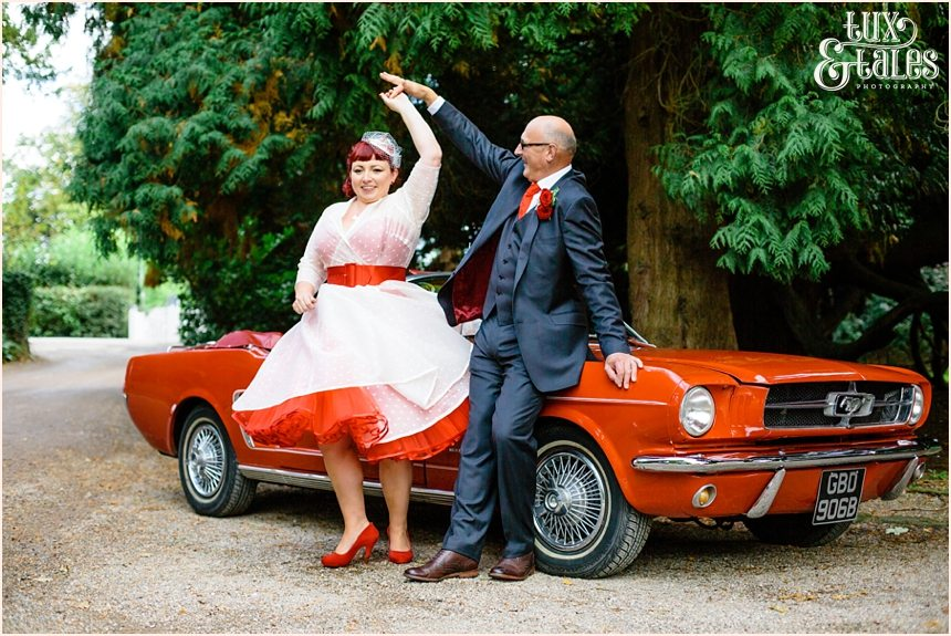 Bride and groom spin in front of red vintage mustang photography