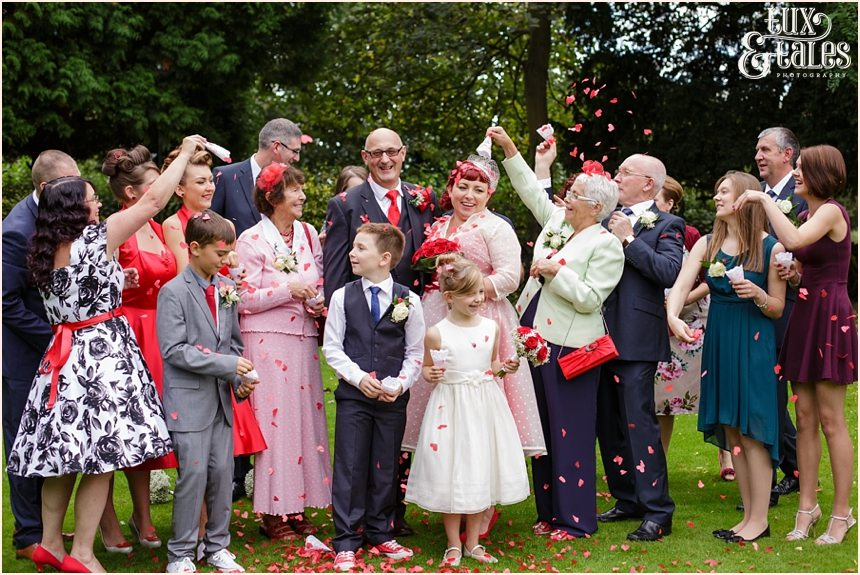 Red heart confetti at vintage wedding