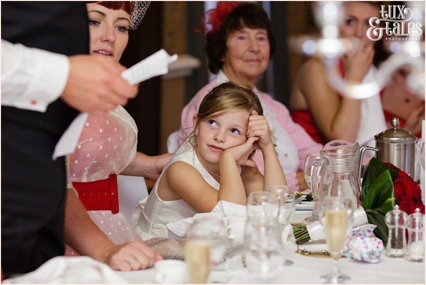 Little girl looks at father giving grooms speech yorkshire wedding